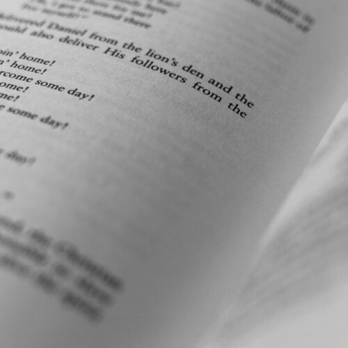 shallow focus photography of book page
